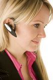Businesswoman Talking On Hands Free Phone Stock Photo