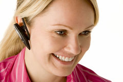 Businesswoman Talking On Hands Free Phone Royalty Free Stock Image