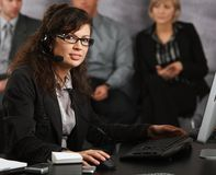 Businesswoman talking on headset Stock Image