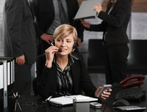 Businesswoman talking on headset Royalty Free Stock Image
