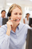 Businesswoman talking into headset Royalty Free Stock Photo