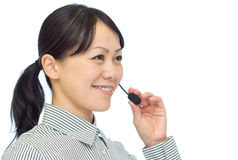 Businesswoman talking with headset Royalty Free Stock Image