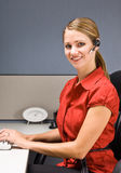 Businesswoman talking on headset at desk Royalty Free Stock Image