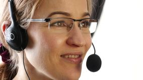 Businesswoman talking on a headset in an office. customer service proffessional. 4K