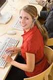 Businesswoman talking on headsets Royalty Free Stock Photo