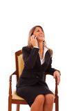 Businesswoman talking at her cellphone Stock Photos