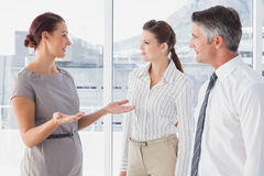 Businesswoman talking with her co-workers Royalty Free Stock Photography