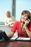 Businesswoman talking on landline phone Stock Photos