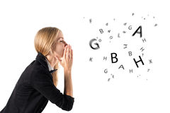 Businesswoman talking and letters coming out of her mouth Royalty Free Stock Photography