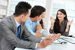 Businesswoman talking during meeting Stock Image