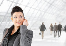 Businesswoman talking on mobile Royalty Free Stock Images