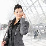 Businesswoman talking on mobile Royalty Free Stock Photography