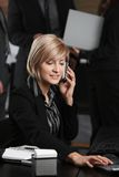 Businesswoman talking on mobile Royalty Free Stock Photos