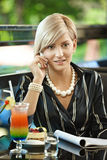 Businesswoman talking on mobile in cafe Royalty Free Stock Image