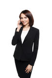 Businesswoman talking on the mobile cell phone Stock Images