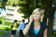 Businesswoman talking on mobile outdoor Stock Photo