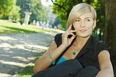 Businesswoman talking on mobile outdoor Royalty Free Stock Images