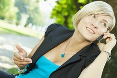 Businesswoman talking on mobile outdoor Stock Photography