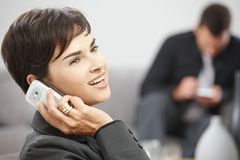 Businesswoman talking on mobile phone Stock Image