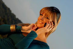 Businesswoman talking on the mobile phone Stock Photos