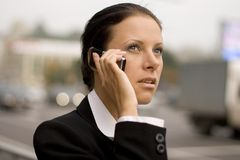 Businesswoman talking by mobile phone Royalty Free Stock Image