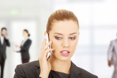 Businesswoman talking on mobile phone. Royalty Free Stock Photos
