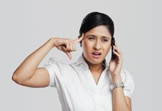 Businesswoman talking on a mobile phone. And looking confused Royalty Free Stock Photos