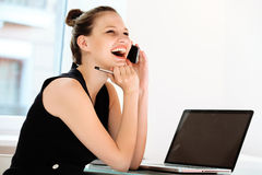 Businesswoman talking on mobile phone in a Office Royalty Free Stock Photos