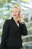 Businesswoman talking on mobile phone outdoors Royalty Free Stock Photo