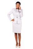 Businesswoman talking mobile phone Stock Photo