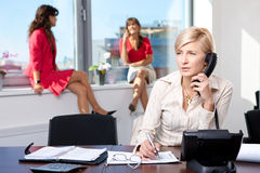 Businesswoman talking on phone Royalty Free Stock Photos