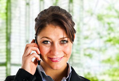 Businesswoman talking at phone Royalty Free Stock Photography