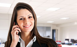 Businesswoman talking at phone Stock Photo