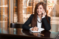 Businesswoman talking on phone. Businesswoman talking on the phone Royalty Free Stock Photo