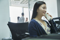 Businesswoman Talking on the Phone Stock Photo