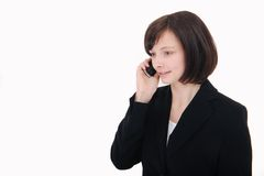 Businesswoman talking on phone. Isolated on a white background royalty free stock photos