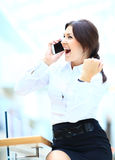 Businesswoman talking on the phone as  winner and laeader Stock Image
