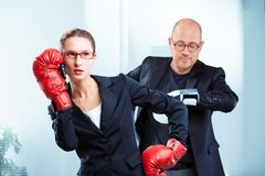 Businesswoman talking on phone with boxing gloves Stock Photo