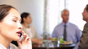 Businesswoman talking on phone at business lunch Royalty Free Stock Photo