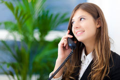 Businesswoman talking at the phone Stock Images