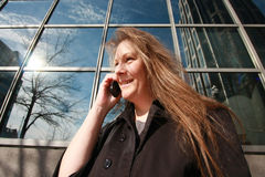 Businesswoman Talking On Phone. Businesswoman Talking On Cell Phone Outside Of Corporate Building Royalty Free Stock Photo
