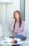 Businesswoman talking on the phone in a coffee shop Stock Photos