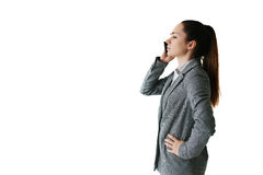 Businesswoman talking on the phone and giving directions Stock Photo