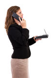 Businesswoman talking on phone and looking up. Isolated on white Royalty Free Stock Images