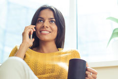 Businesswoman talking on the phone and looking up Royalty Free Stock Image