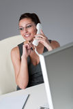 Businesswoman talking on the phone at office Stock Photography