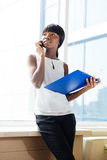 Businesswoman talking on the phone in office Stock Images