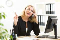 Businesswoman talking on phone in office Royalty Free Stock Photography