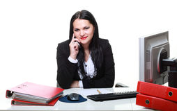 Businesswoman talking phone at office desk Stock Photo