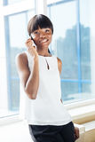 Businesswoman talking on the phone in office Royalty Free Stock Image